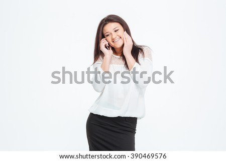 Smiling businesswoman talking on the phone isolated on a white background - stock photo