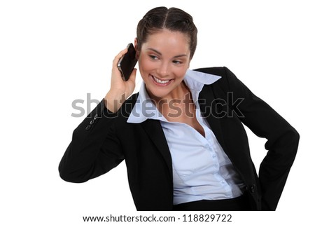 Smiling businesswoman using a cellphone