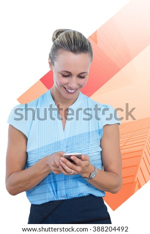 Smiling businesswoman using her smartphone against skyscraper - stock photo