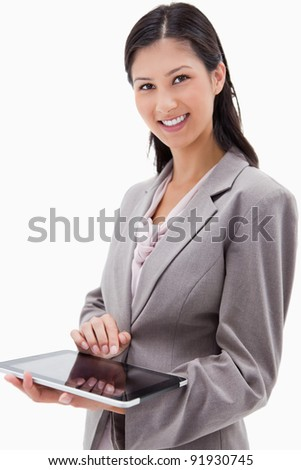 Smiling businesswoman using tablet against a white background