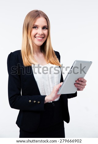 Smiling businesswoman using tablet computer isolated on a white background - stock photo