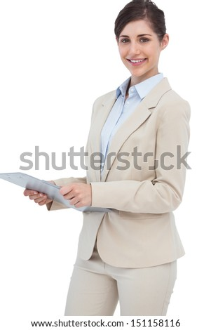 Smiling businesswoman with clipboard on white background  - stock photo