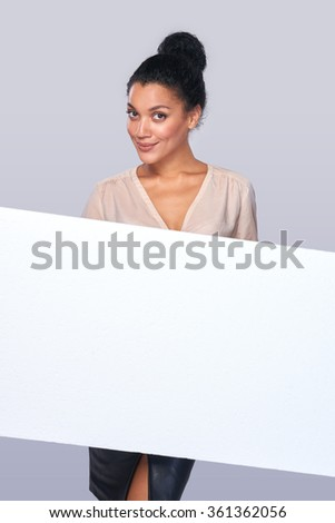 Smiling businesswoman with parcel - stock photo