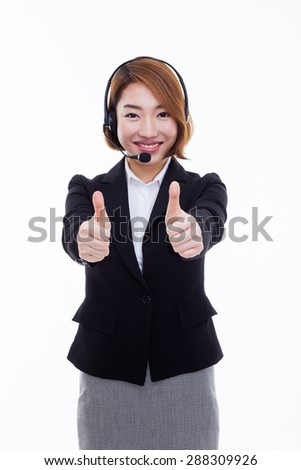 Smiling call center operator business woman and showing thumb  isolated on white background.  - stock photo