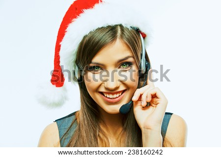 Smiling call center operator, red Christmas hat. Santa girl. - stock photo
