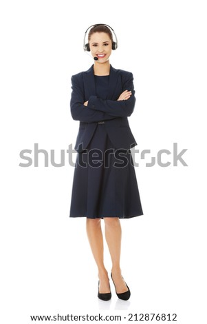 Smiling call center woman with headset - stock photo