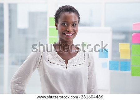 Smiling casual businesswoman posing in the office