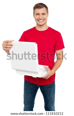 Smiling casual man holding pizza box isolated against white background