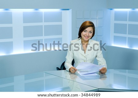 smiling caucasian business lady at office desk