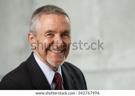 Smiling Caucasian male wearing a business suit