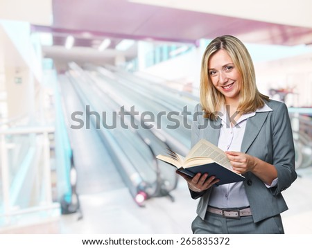 smiling caucasian woman with book - stock photo