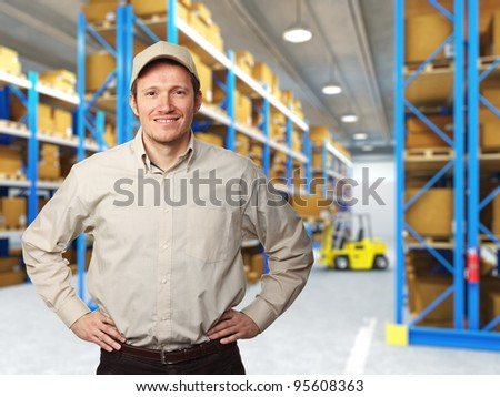 smiling caucasian worker in warehouse - stock photo