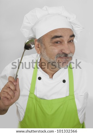 smiling chef in green apron