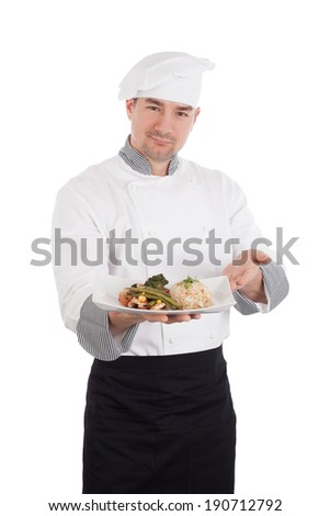 Smiling chef showing and holding a plate of prepared food. Isolated on white background - stock photo