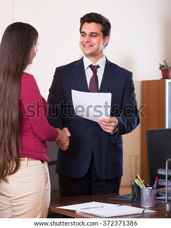 Smiling chief manager hiring assistant after job interview on permanent basis