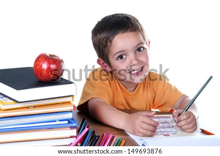 smiling child at her desk studying - stock photo