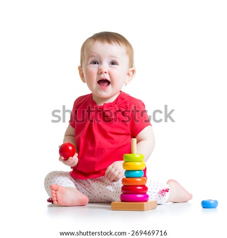 smiling child baby playing with color pyramid toy isolated