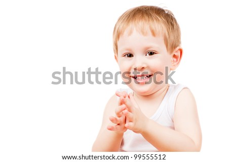 smiling child claps his hands, isolated on white