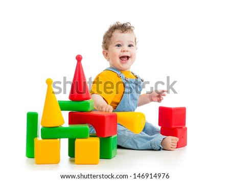 smiling child playing building blocks - stock photo