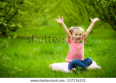 smiling child playing in the garden - stock photo