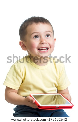 smiling child playing pc tablet - stock photo