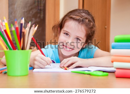Smiling child writing - stock photo