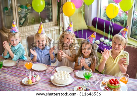 Smiling children at a birthday party - stock photo