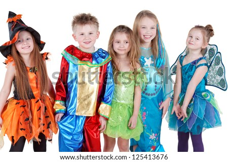 Smiling children in carnival costumes  stand in line - stock photo