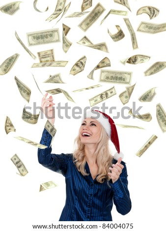 Smiling christmas girl catching falling dollars banknotes wearing Santa hat. Isolated on white background. - stock photo