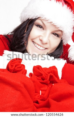 smiling christmas woman holding presents bags - stock photo