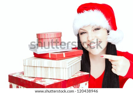 smiling christmas woman pointing presents over white background - stock photo