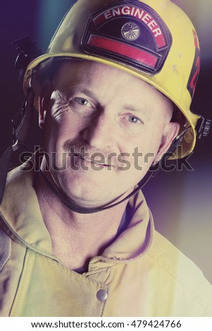 Smiling closeup fireman wearing helmet