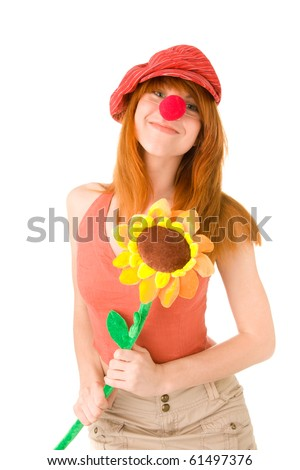 Smiling clown girl with flower - stock photo