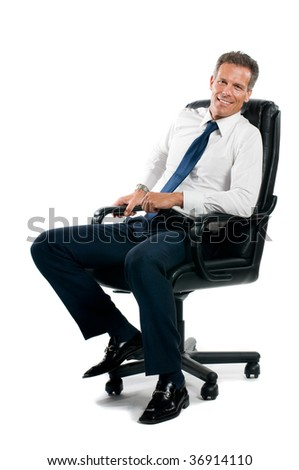 Smiling confident businessman sitting on chair and looking at camera isolated on white background - stock photo