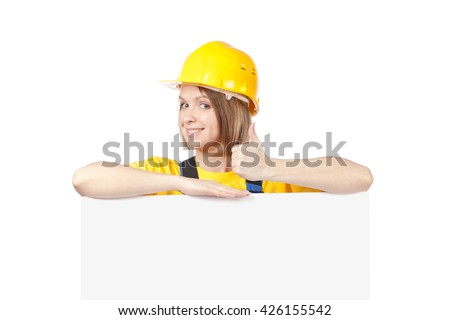 smiling construction female worker above banner with empty copy space for you text isolated on white background. advertisement blank board. your text here. thumb up gesture