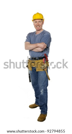 Smiling construction worker on white background with arms folded - stock photo