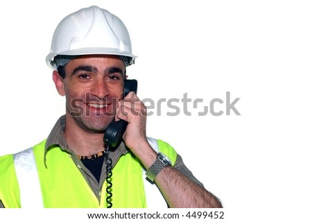 smiling construction worker with a phone