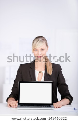 Smiling consultant shows something on laptop isolated on