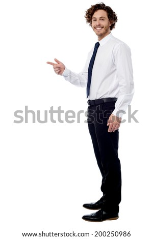 Smiling corporate man pointing something - stock photo