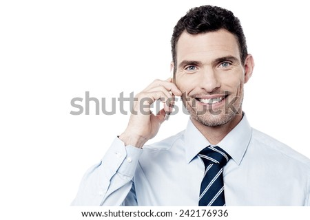 Smiling corporate man using his mobile phone - stock photo