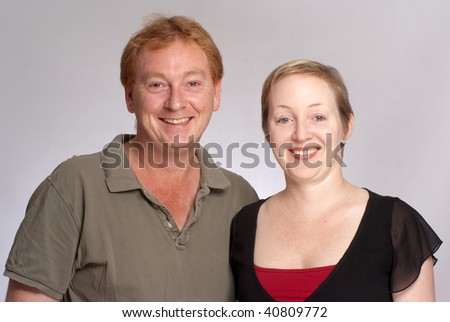 Smiling couple against a a white background - stock photo