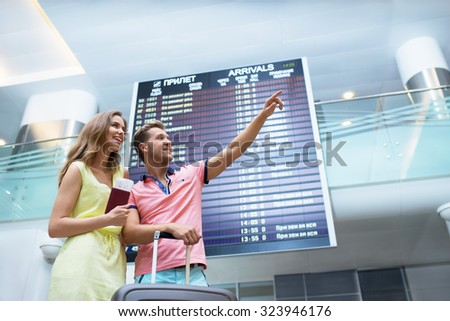 Smiling couple at the airport  - stock photo