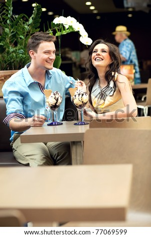 Smiling couple at the cafe - stock photo