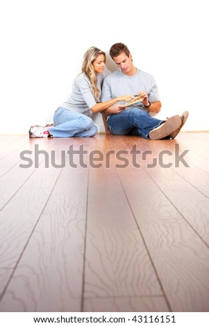 smiling couple choosing color for the  interior wall of home. - stock photo
