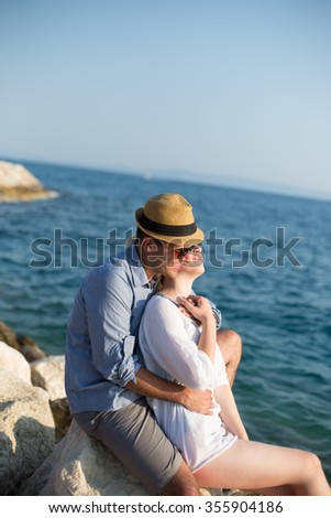 Smiling couple enjoying time together at the beach
