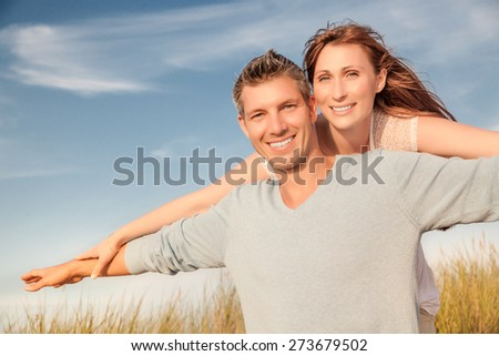 smiling couple flying  on summer travel - stock photo