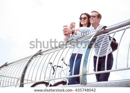 Smiling couple having coffee - stock photo