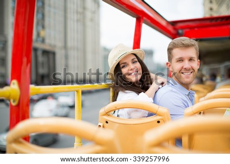 Smiling couple in a tour bus - stock photo