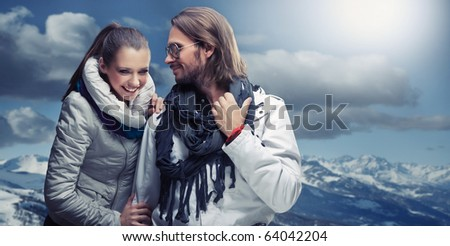Smiling couple in the mountain - stock photo