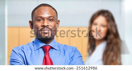 Smiling couple of business people - stock photo